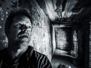 film director Greg McDonald in scary horror cave