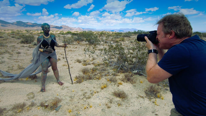 film director Greg McDonald photographs alien in behind the scenes