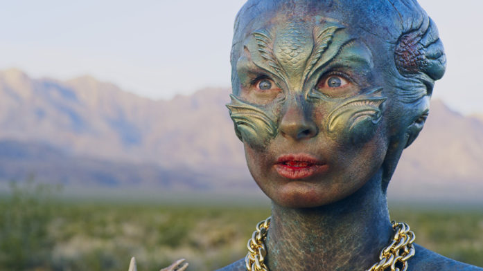 an alien lost in the desert discovers a man