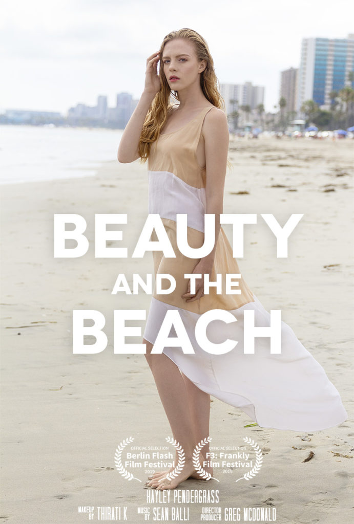 woman in a pretty dress stands on the beach in the eco fashion film, Beauty And The Beach
