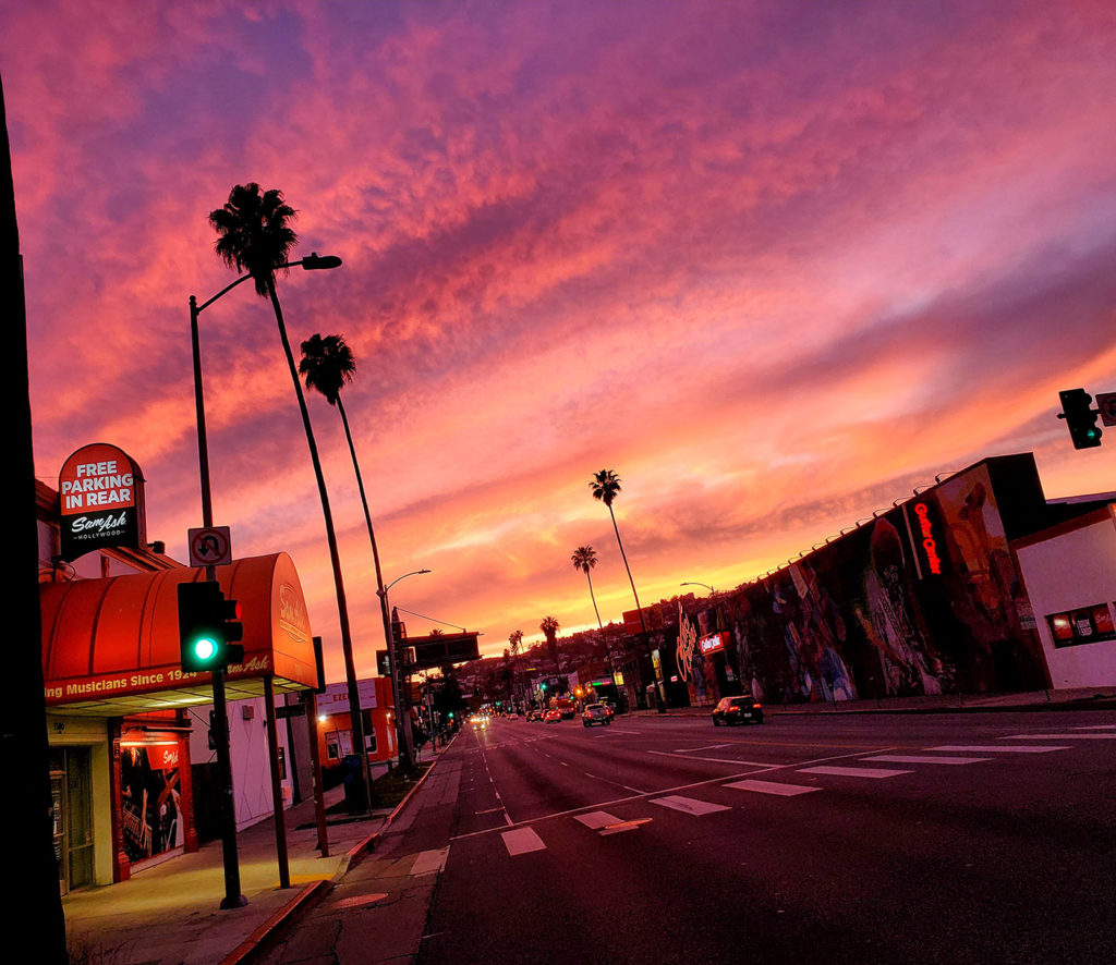 empty Sunset Blvd in Hollywood during a colorful sunset during the shut down