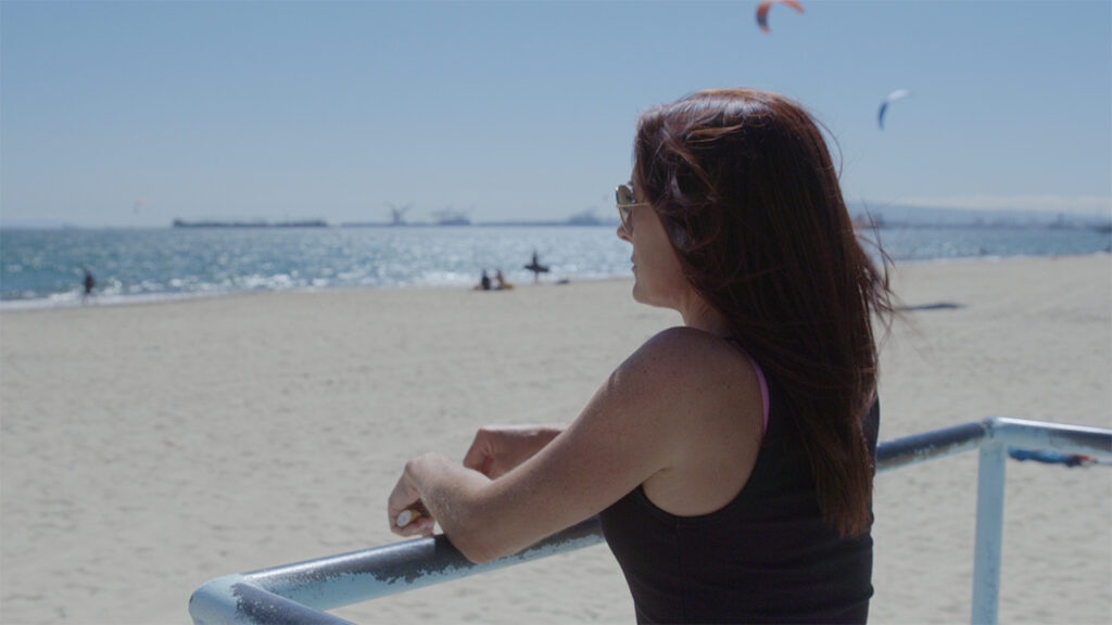 woman at the beach in an episode of a business video series on hemp