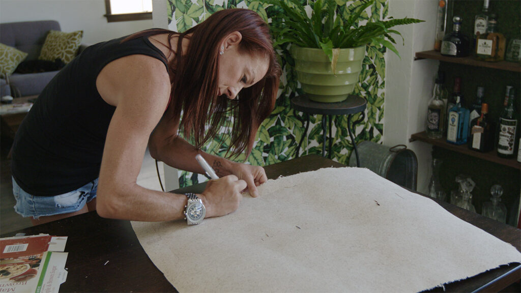 cutting hemp paper in an episode of a video series on hemp